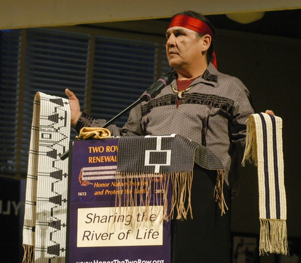 Jake Edwards of the Onondaga Nation Council of Chiefs holding the Canandaigua Treaty Belt and the Two Row Wampum Belt at event in January in Syracuse