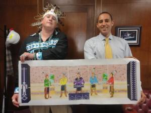 Brandon Lazore and Mayor Svante Myrick with mural design