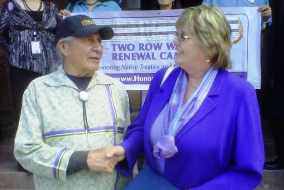 Handshake: Oren Lyons, Onondaga Nation Faithkeeper and a Two Row Wampum expert is pictured outside Albany City Hall with Albany Common Councilmember Cathy Fahey. Credit Dave Luca/WAMC