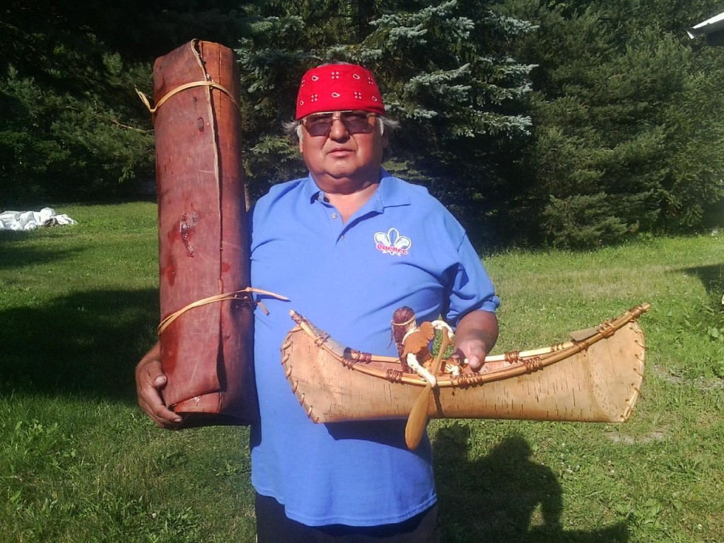 Richard Big Kettle with Birchbark canoe